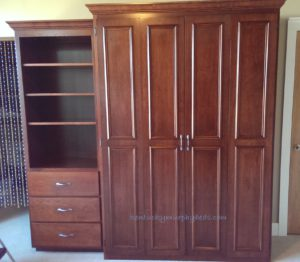 Cherry queen size Murphy bed with one bookcase in a condominium