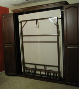 Cherry queen size Murphy bed, raised cathedral arch doors, frame up ready to lower