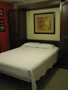 Cherry queen size Murphy bed, raised cathedral arch doors in open position