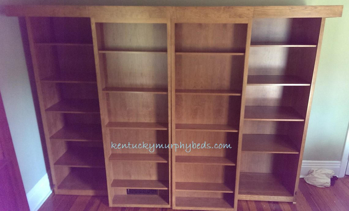 Cherry Murphy bed with bookcase doors and accessory bookcases