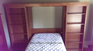 cherry full size murphy bed with bookcase doors and accessory bookcases doors open and bed down