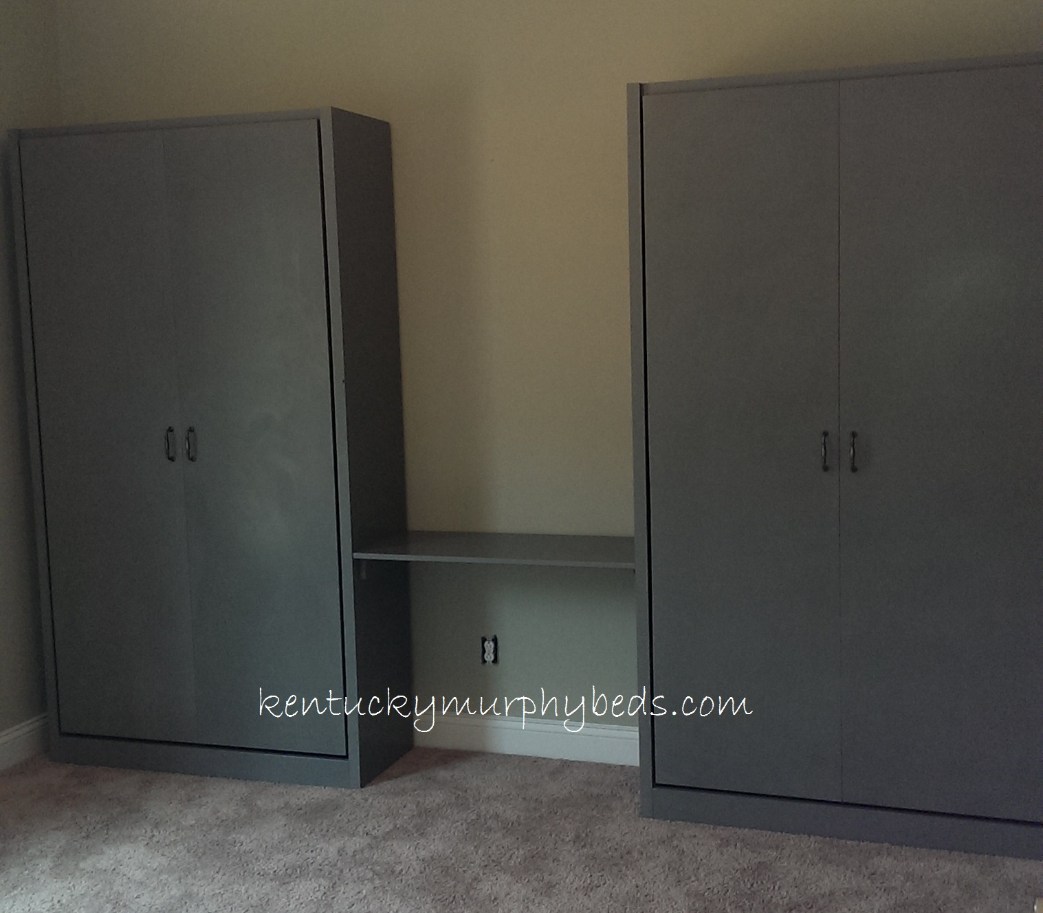 Twin Murphy beds with desk top