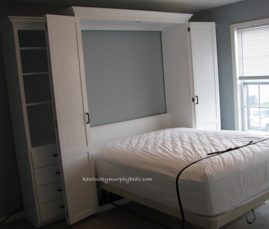 Queen size bifold door Murphy bed with side cabinet Murphy desk and additional book case, shown bed deployed, guest room
