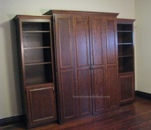 oak full size XL Murphy bed with accessory cabinets 2018; bifold doors, surface trim, crown molding, murphy beds of central kentucky