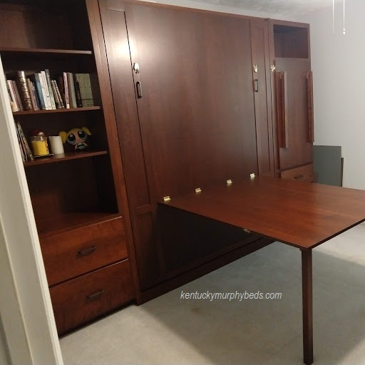 Maple queen panel door Murphy bed, integrated table shown folded down, 2 side bookcases - one with fold down Murphy desk, autumn finish.