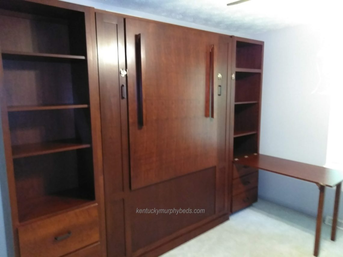 Maple queen panel door Murphy bed with front fold down table, side cabinets including one Murphy fold down desk