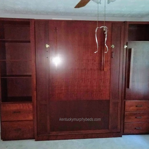 Maple queen panel door Murphy bed with special side cabinets, fold down table and fold down Murphy desk - closed view
