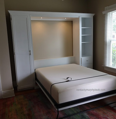 White queen panel door Murphy bed with shaker trim, crown molding, and dimmable LED lights, one side full cupboard and one side book case-drawer cabinet