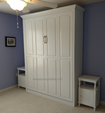 White queen panel door Murphy bed with solid wood raised cathedral arch doors and crown molding - closed view