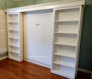 White painted panel style Murphy bed with bookcase doors and side accessory bookcases - bookcases open, coolest Murphy bed, custom design
