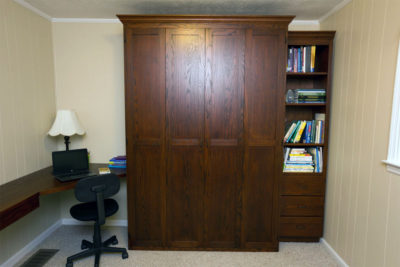 shaker trim and crown molding on solid oak doors; wrap around desk top