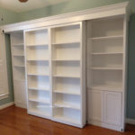 White painted panel-style Murphy bed with Bookcase Slider Doors