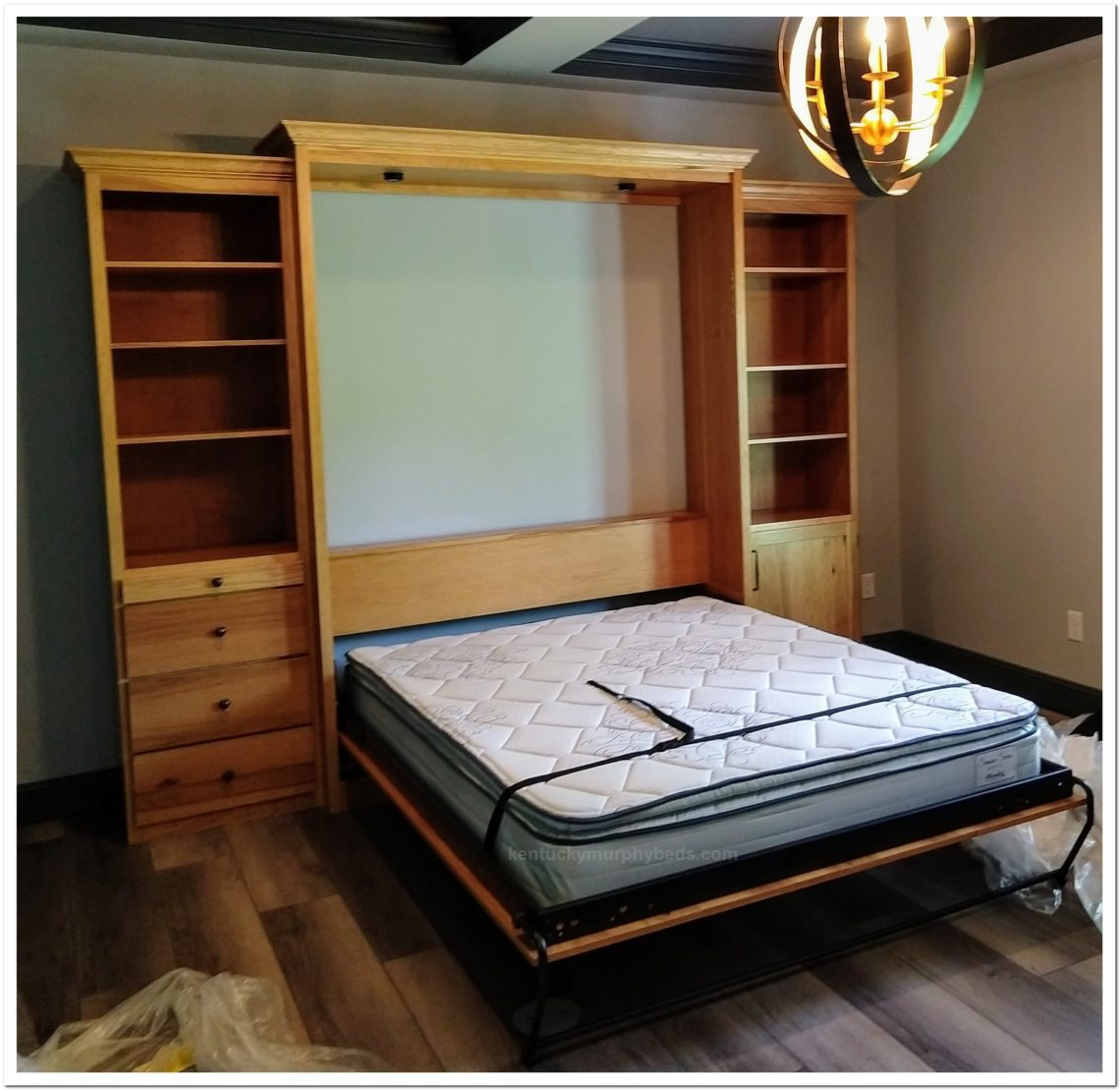 queen murphy bed cabinet with two accessoy cabinets. make the most of any spare room.