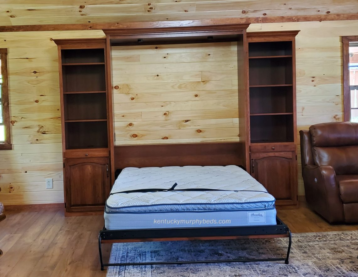 queen size murphy bed with bookcases, in hickory with autumn finish, open view shown in woodland cottage , May 2020